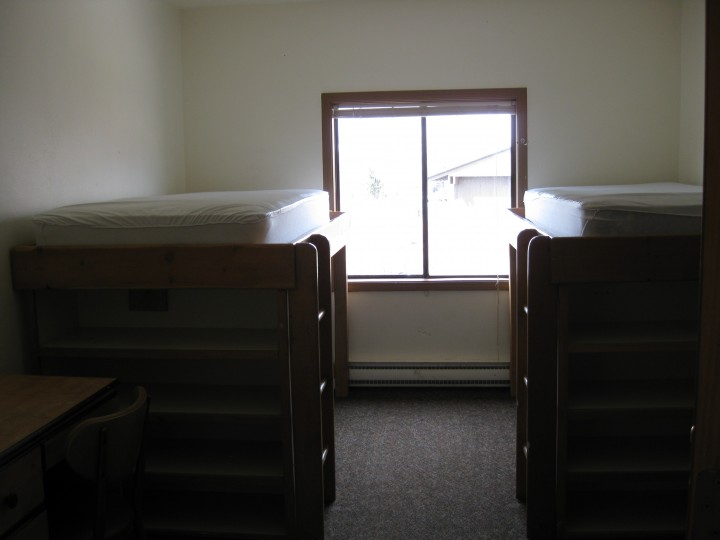 Typical bedroom; double rooms feature single desk, dresser; loft units have built-in shelving
